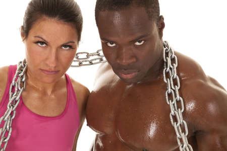 An interacial couple working out with a chain.