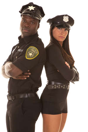 Photo for A male cop and a female cop with their backs together and arms folded - Royalty Free Image