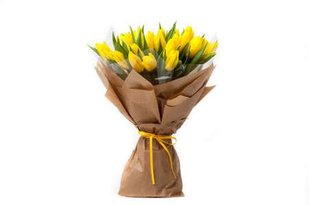 Foto de yellow tulips in a paper bouquet associated ribbon. Valentine's Day - Imagen libre de derechos