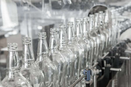 on the conveyor belt glass bottles. factory shop for the production of glass bottles and beverage