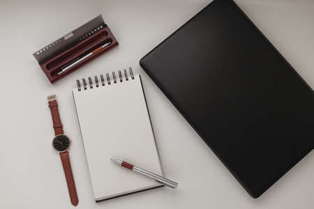 Photo pour Black spiral notebook with a silver fancy pen on top of it in the middle of a black backdrop. Minimalist workplace. - image libre de droit