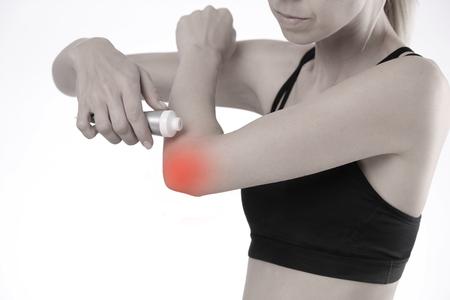 Photo pour Woman suffering from elbow pain applying pain relief cream - image libre de droit