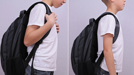 Good bad posture concept. School child with backpack