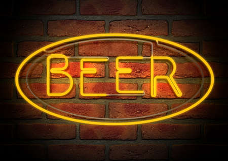An illuminated orange neon sign with the word beer on it mounted on a brick wall