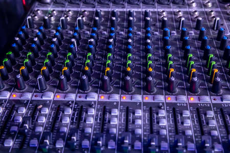 Photo for Analog studio sound mixer closeup with laptop and sound wave form in the background. - Royalty Free Image