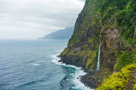 Wild atlantic coast, Island Madeira coastline - impressiv mountain with waterfall - Ponta do Poiso