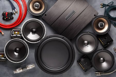 Photo pour car audio, car speakers, subwoofer and accessories for tuning. Dark background. Top view. - image libre de droit