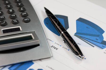 Foto für Financial statements. Calculator and pen on financial charts. Close-up. Business concept - Lizenzfreies Bild