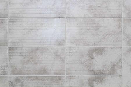 Photo pour Gray tiles in the kitchen close up - image libre de droit