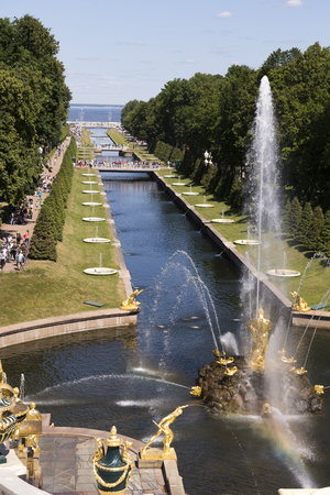 Peterhof, Saint-Petersburg, Russia - July 6,2015: Each guest Peterhof tends to witness the great miracle of the human mind - the unique Grand Cascade. This building is considered to be the most important of the entire grand fountains of Peterhof. The syst