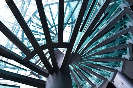Photo pour Metal spiral staircase with glass steps. - image libre de droit