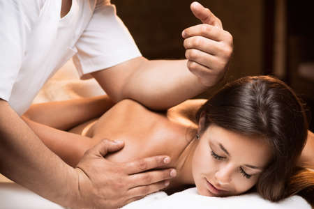 Photo for The girl enjoys deep tissue massage - Royalty Free Image