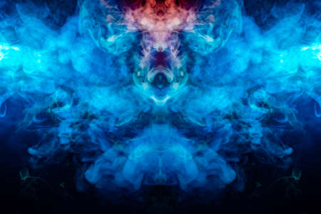 Photo for Smoothly flowing waves of smoke create a cosmic pattern, in the form of a fish head with a red crown, illuminated with blue light, against a black background. - Royalty Free Image