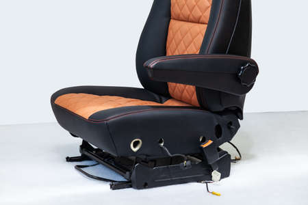 Photo pour A view of a part of the interior of the car three seats from leather of black and beige color, one of them is undercovered in a vehicle interior design workshop. Auto service industr - image libre de droit