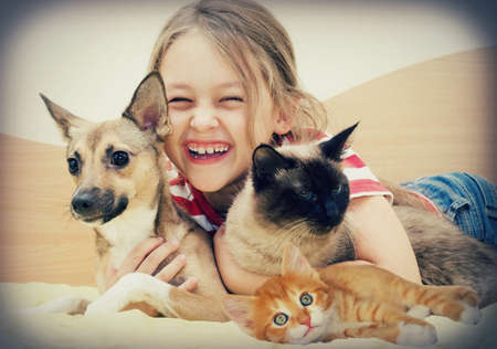 laughing girl and pets