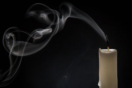 Photo for Smoke and extinct candle on a black background - Royalty Free Image