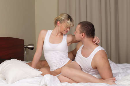 Foto per young couple in bed, man and woman on white blanket - Immagine Royalty Free