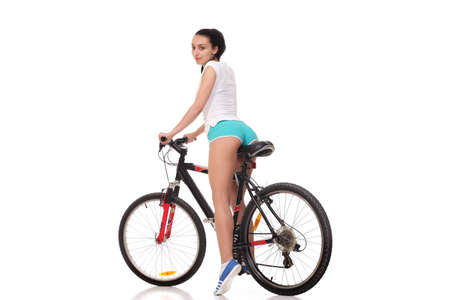 Photo for young athletic and slim girl on a bicycle - Royalty Free Image