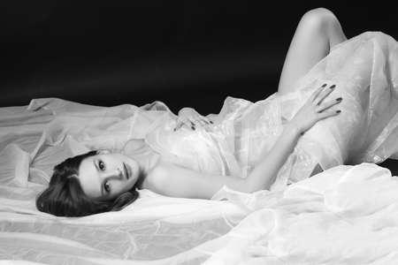 Photo pour young beautiful female on a dark background - image libre de droit