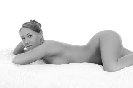 Photo pour young sexy nude woman on white blanket - image libre de droit