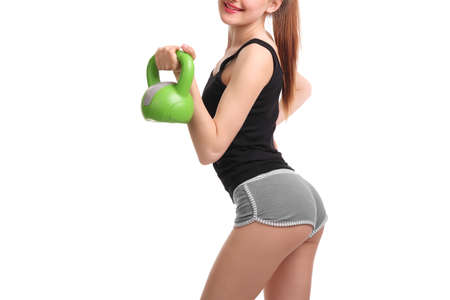 Photo for Nice sexy young woman doing workout with dumbbell - Royalty Free Image