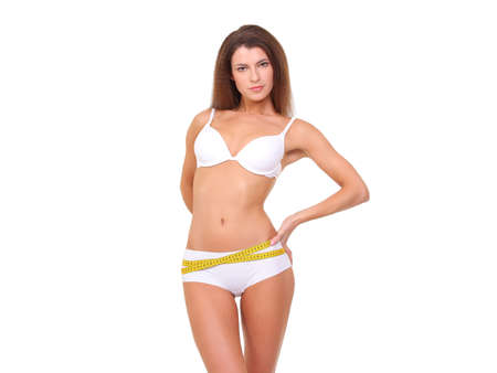 Photo pour Woman measuring her slim body in white linen - image libre de droit