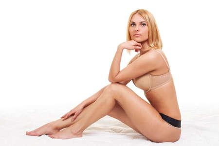 Photo pour Beautiful young girl in sexy body underwear posing in white studio - image libre de droit