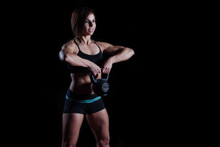 Photo for fitness Kettlebells swing exercise woman workout at gym - Royalty Free Image