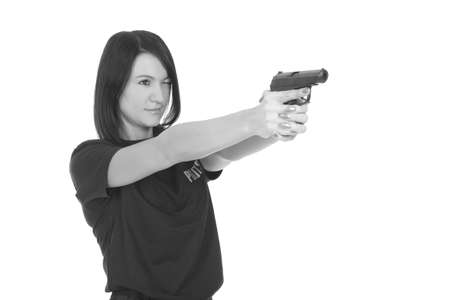 Photo pour young police girl with gun on a white background - image libre de droit