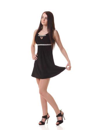 Photo pour Young sexy girl in black little dress - image libre de droit