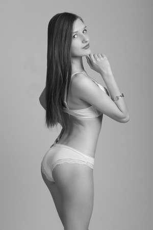 Foto de Sexy woman in white lingerie slim figure. - Imagen libre de derechos