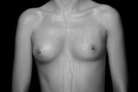 Foto de young girl with small tits on a black background - Imagen libre de derechos