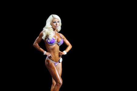 Photo pour young fitness girl posing in a bikini - image libre de droit