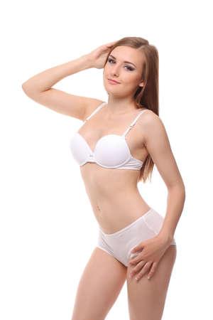 Photo pour young woman with a slim figure in white lingerie - image libre de droit