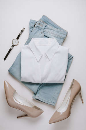 Foto per Women's clothing on a pale background. Flat lay and top view - Immagine Royalty Free