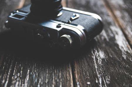 Old camera on dark wooden background