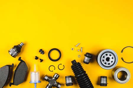 Photo pour Set of car parts for maintenance on yellow background - image libre de droit