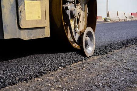 Photo for road equipment lays asphalt, road works, paver, road repairs - Royalty Free Image