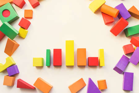Photo pour Children'S Designer From Blocks Of A Different Form. Construction, childrens designer, blocks, cubes for children on white background, close-up, house, childrens play, childrens toy - image libre de droit
