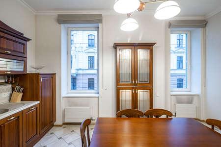 Photo pour Luxury interior of kitchen in modern apartment. Wooden furniture. Windows. - image libre de droit