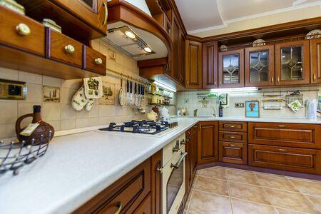 Foto de Warm and inviting kitchen with large kitchen island, cherrywood cabinets, gold granite counter tops and modern stainless steel refrigerator. Modern kitchen in luxury house. - Imagen libre de derechos