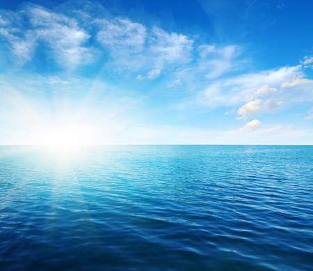 Photo pour Blue sea water surface on sky - image libre de droit