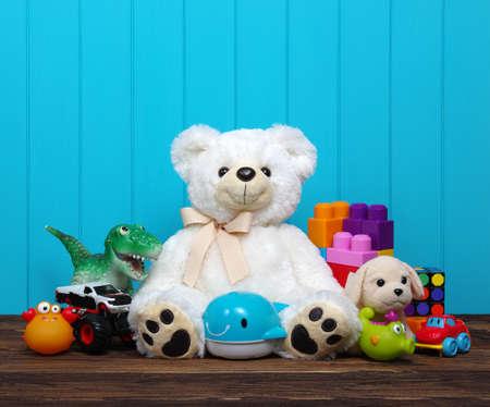 Photo pour Toys on a wood background - image libre de droit