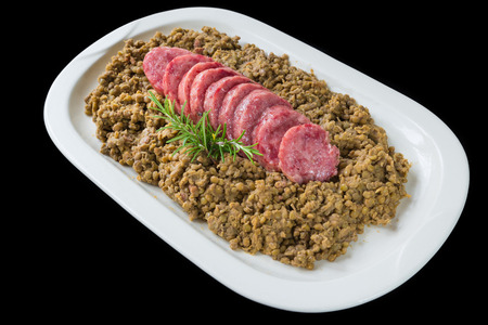 Photo pour Cotechino (pork sausage) with lentils. Traditional Italian dish.  According to tradition, it is served with lentils on New Year's Eve, because it is said that lentils bring money for the coming year - image libre de droit