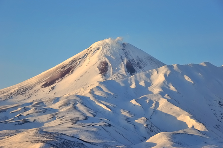 Kamchatka: winter view of eruption active Volcano. Russia