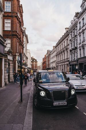London, United Kingdom - August 31, 2019: Electric LEVC TX London black cab on a street in Covent Garden, London. Black cabs are an important part of the capital's transport system. Selective focus.