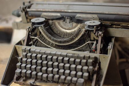 Foto per Old, antique typewriter close-up in the dust. - Immagine Royalty Free