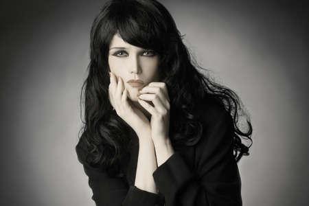 Fashion portrait brunette woman with black hair.