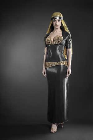 Fashion model in elegant dress. Woman in oriental dancer costume