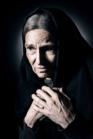 Sad old woman Senior woman in sorrow depressed portrait with wrinkled face